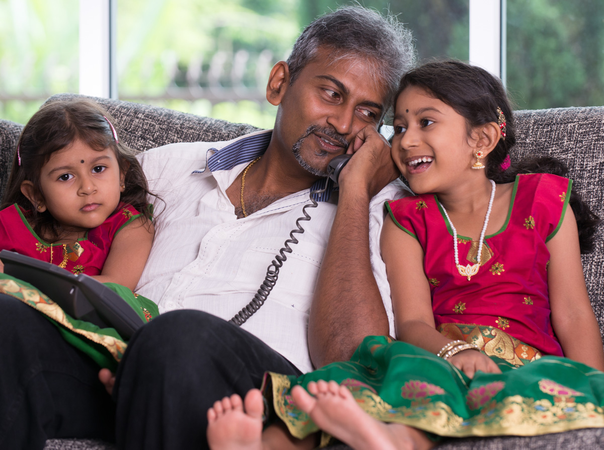indian father with his daughter on phone conversation lifestype photo